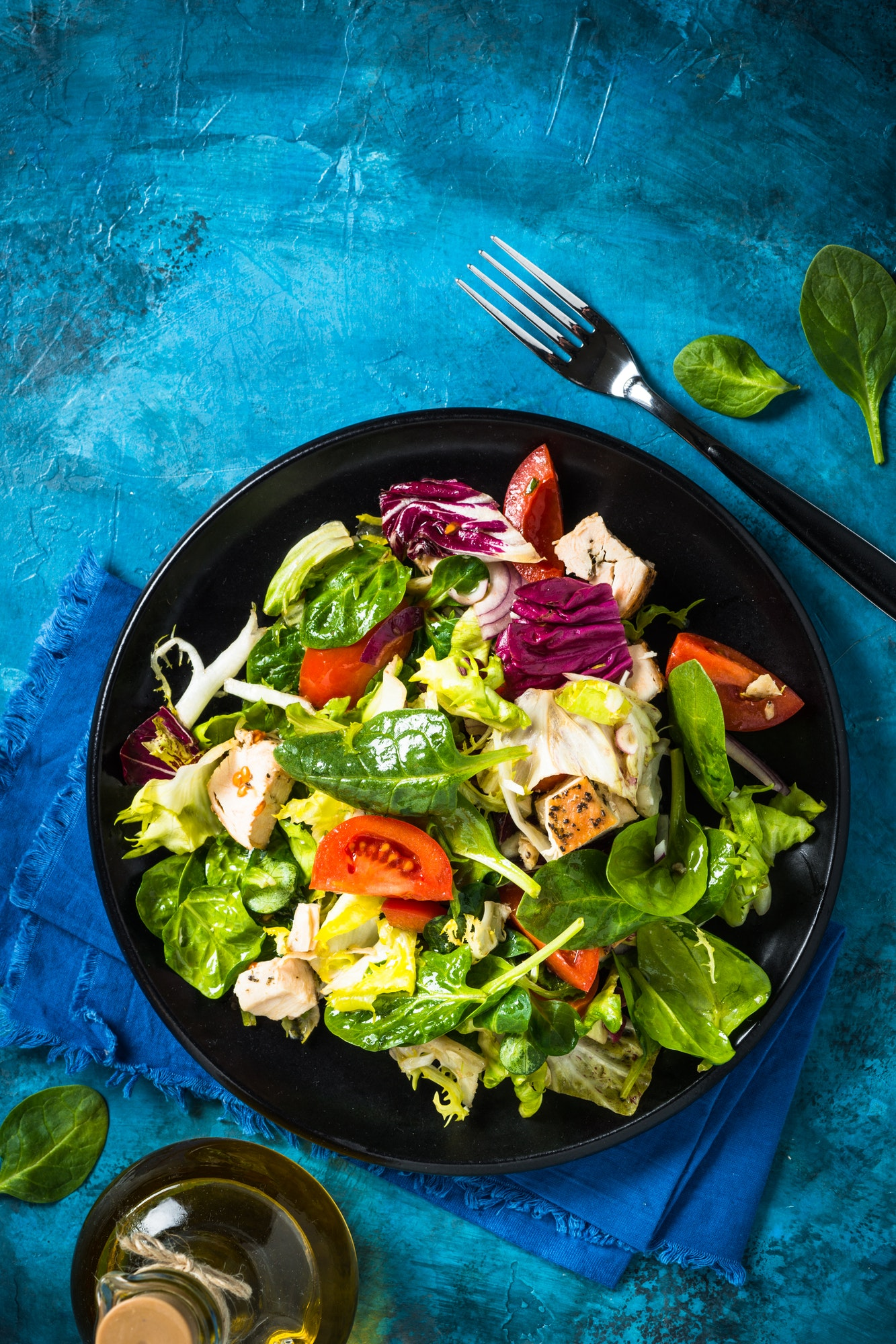Green salad with chicken and vegetables top view