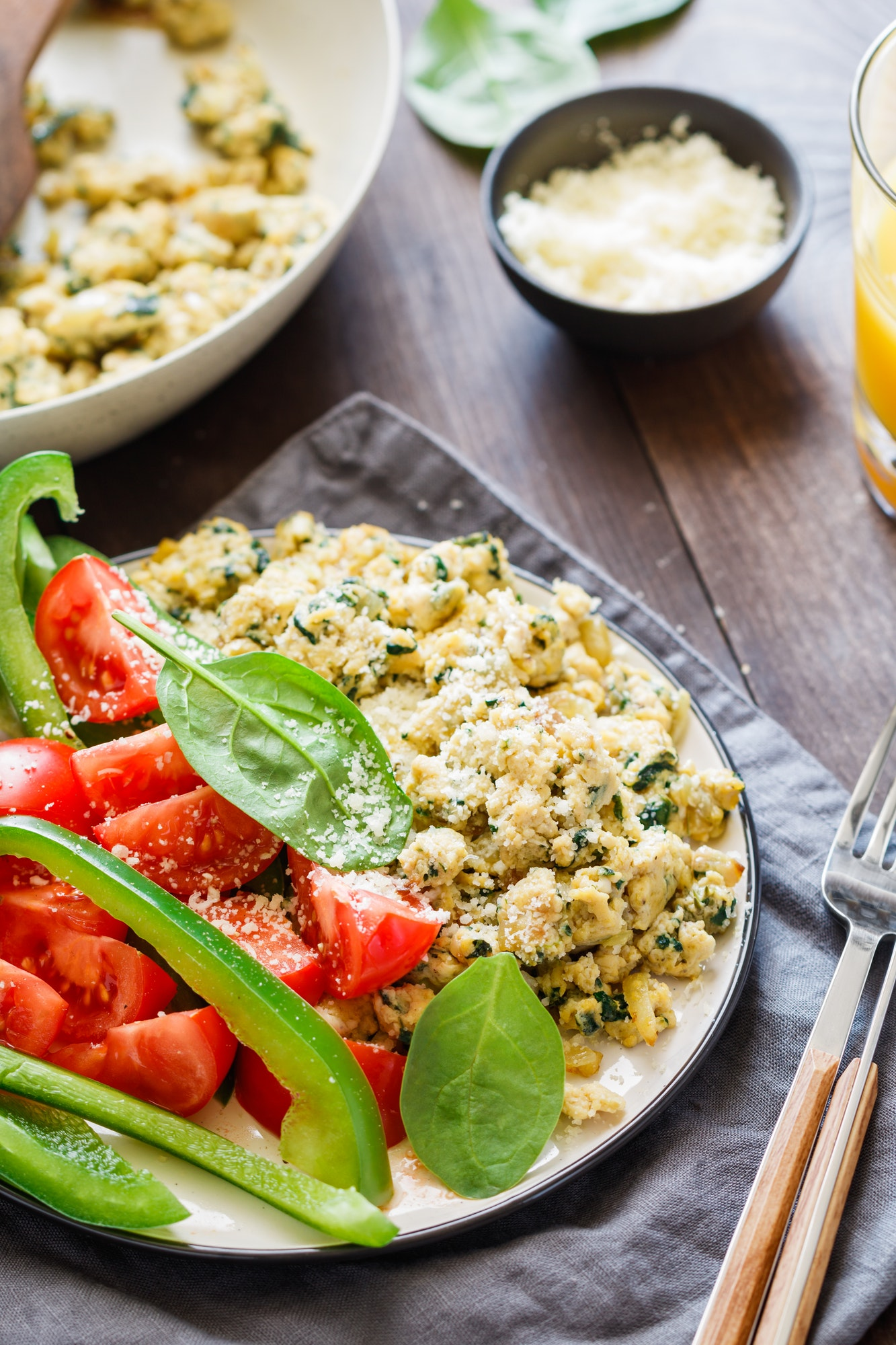 Breakfast table with a portion of spinach scrambled eggs